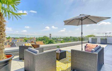 Prachtige penthouse met uniek panoramisch uitzicht + een dakterras van 100m²